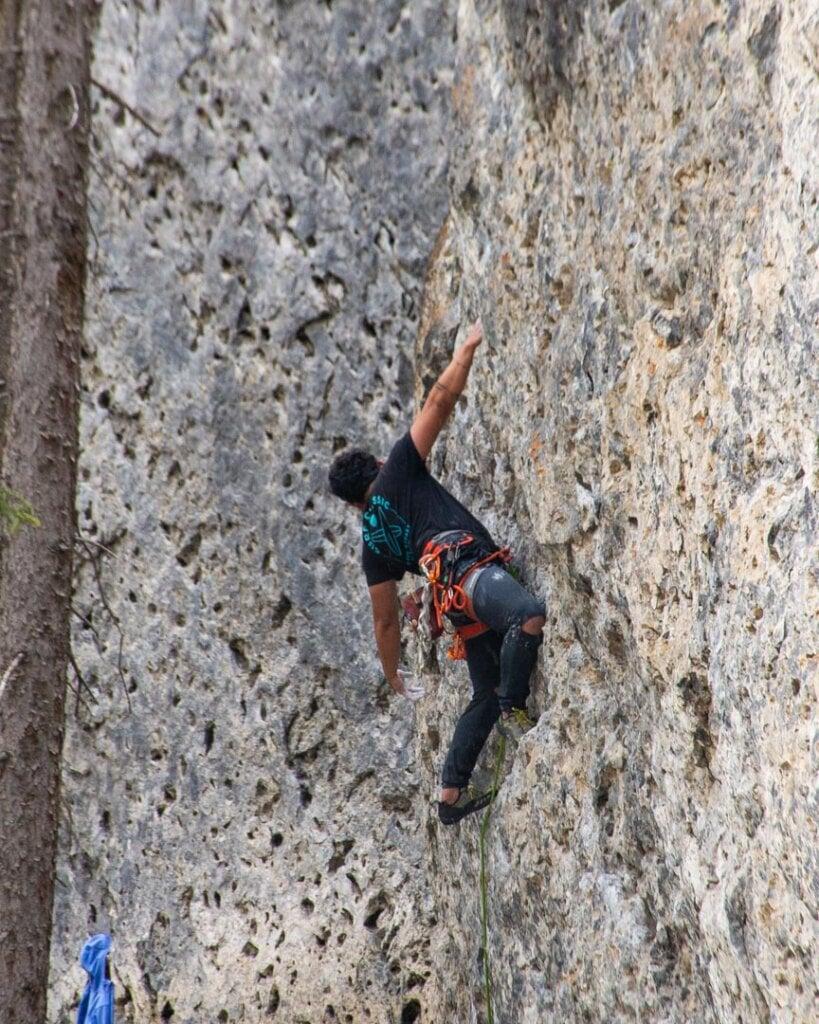 A man climbs a rockface at Grassi Lakes, Canmore