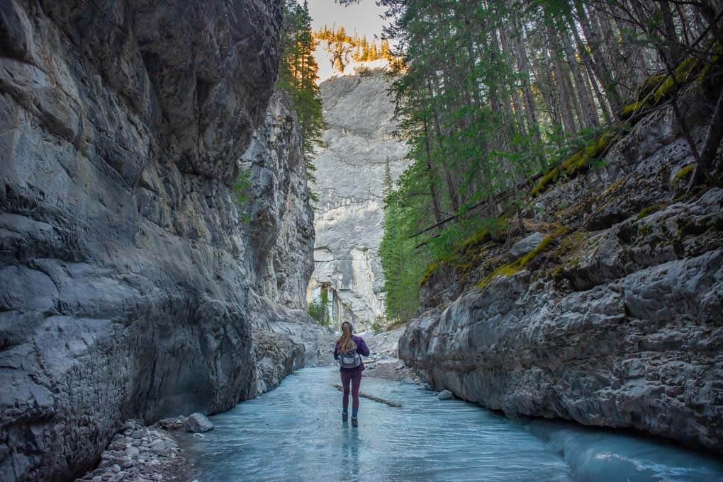 A lady walsk through Grotto canyon in winter in Canmore