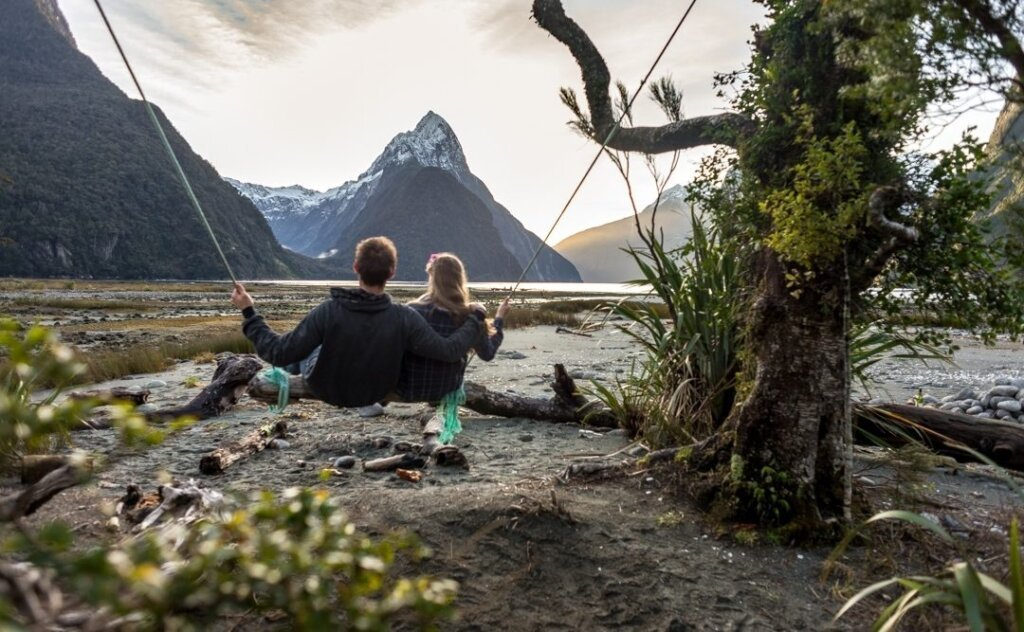 A couple on the milford sound swing