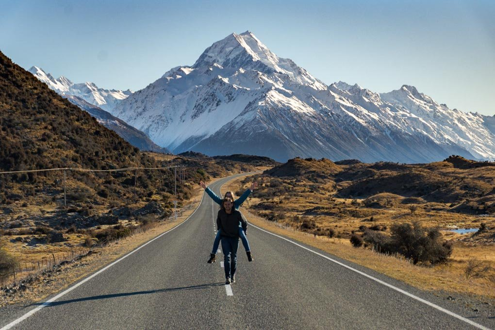 couple posing for the camera on the road to Mount Cook