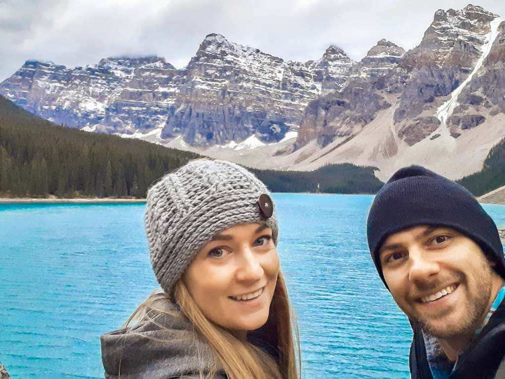 A couple take a selfie at Moraine Lake in Banff National Park