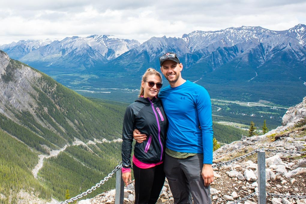 Bailey and daniel from Destinationlesstravel standing on the first viewpoint on the trail to Ha Ling Peak, Canmore