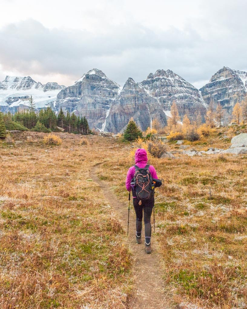 A lady walking on a trail in the Larch Valley