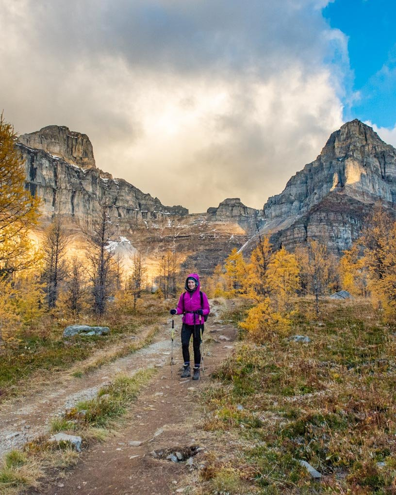 A lady hiking on the Larch Valley Trail