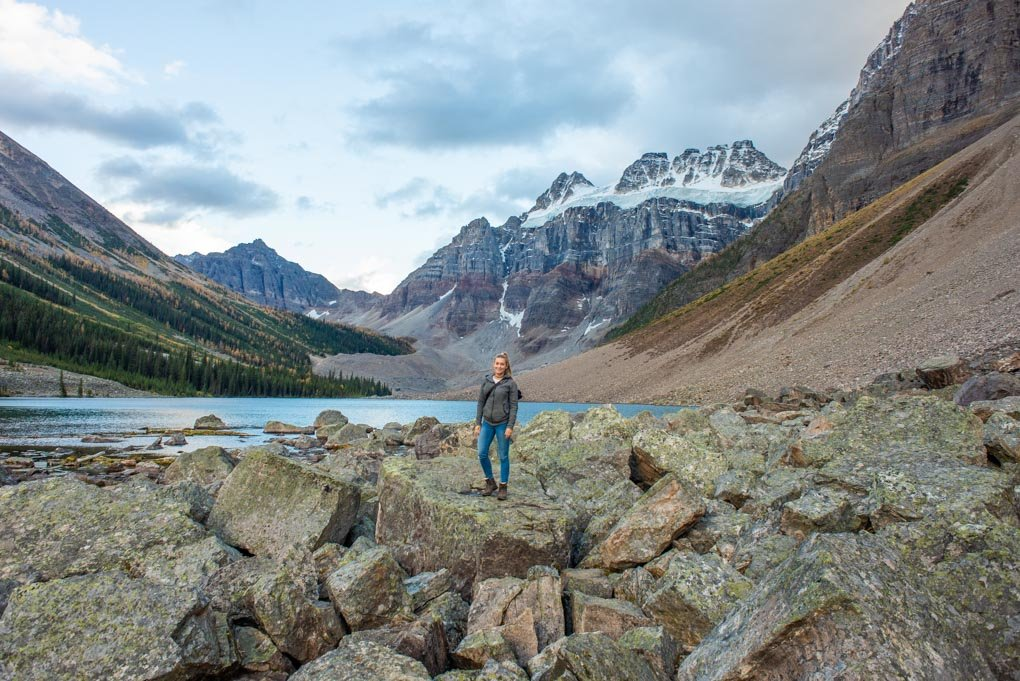 A lady stands on a rock at Consolation Lakes in Banff National Park
