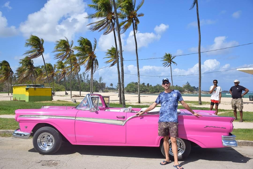a pink vintage car in havana cuba