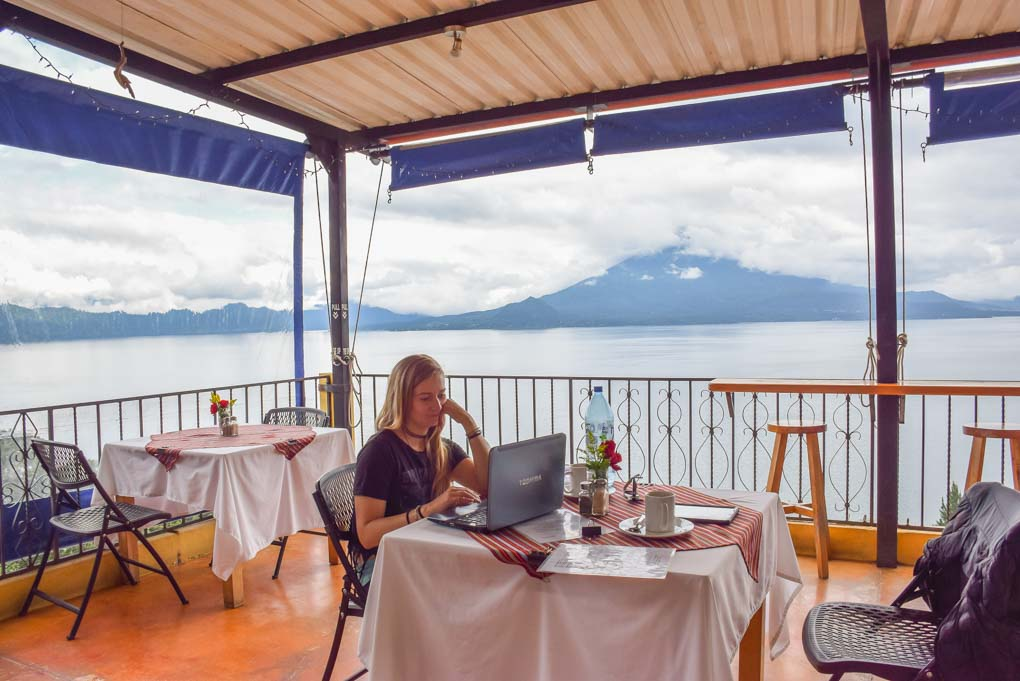 bailey working while she waits for lunch at a cafe in lake atitlan