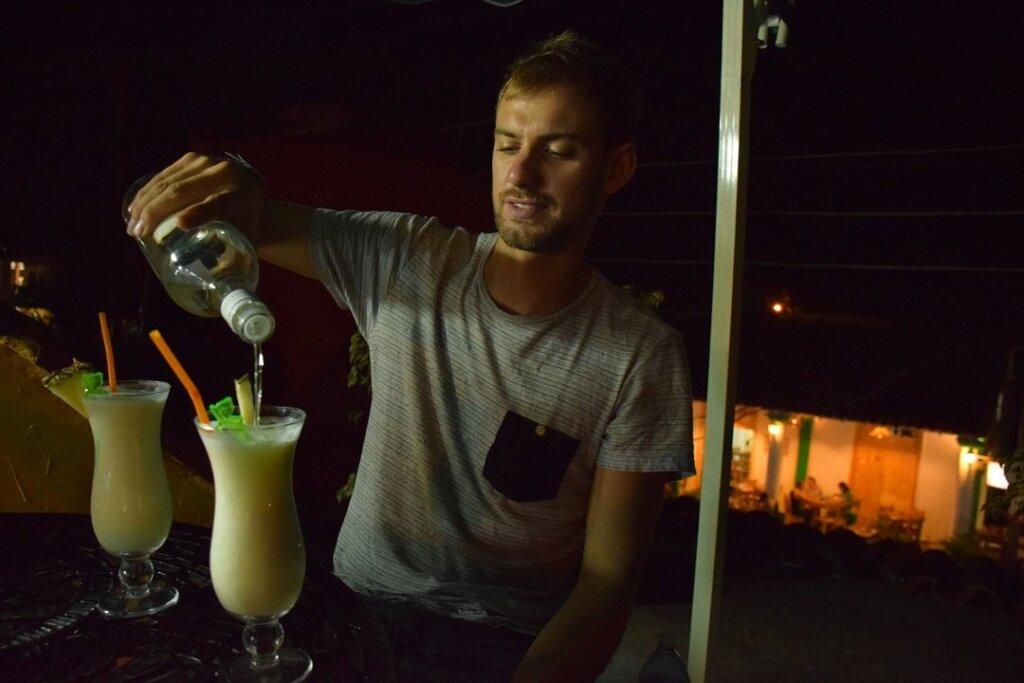 pouring rum into a pina colada in Havana, Cuba