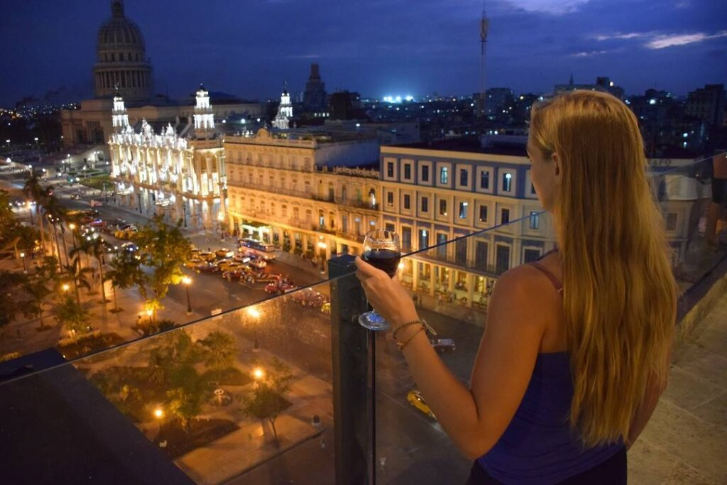 bailey drinking wine and taking in the view of Havana from the central hotel