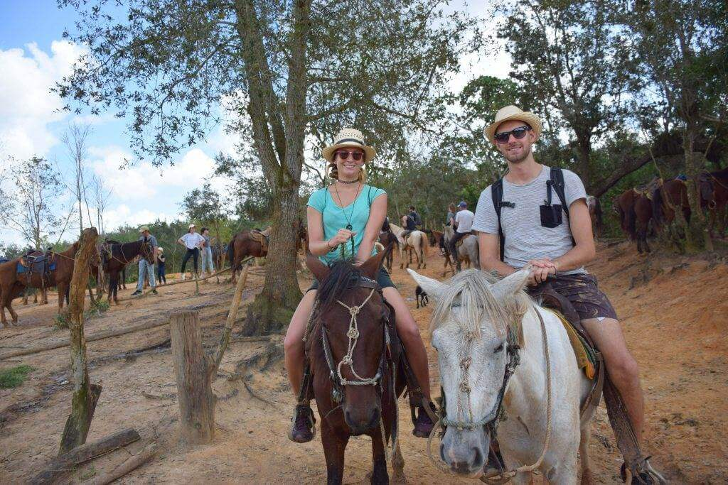 two people riding horses in the Valley of Vianles