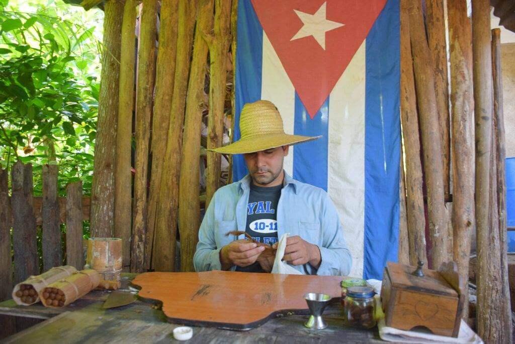 a cuban doing a cigar rolling demonstration in vinales cuba