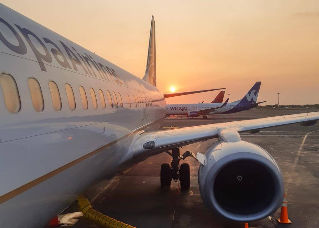 boarding an airplane at sunrise