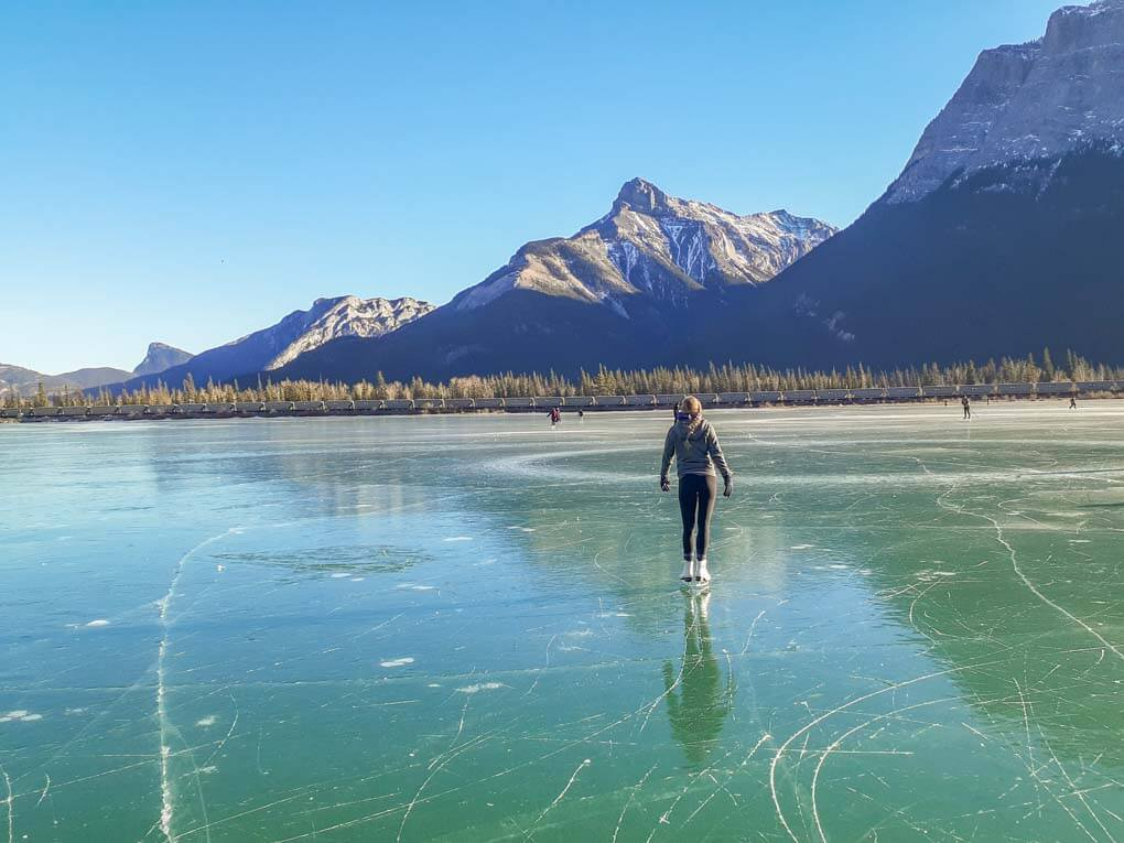 A lady skates at Gap Lake, Canmore