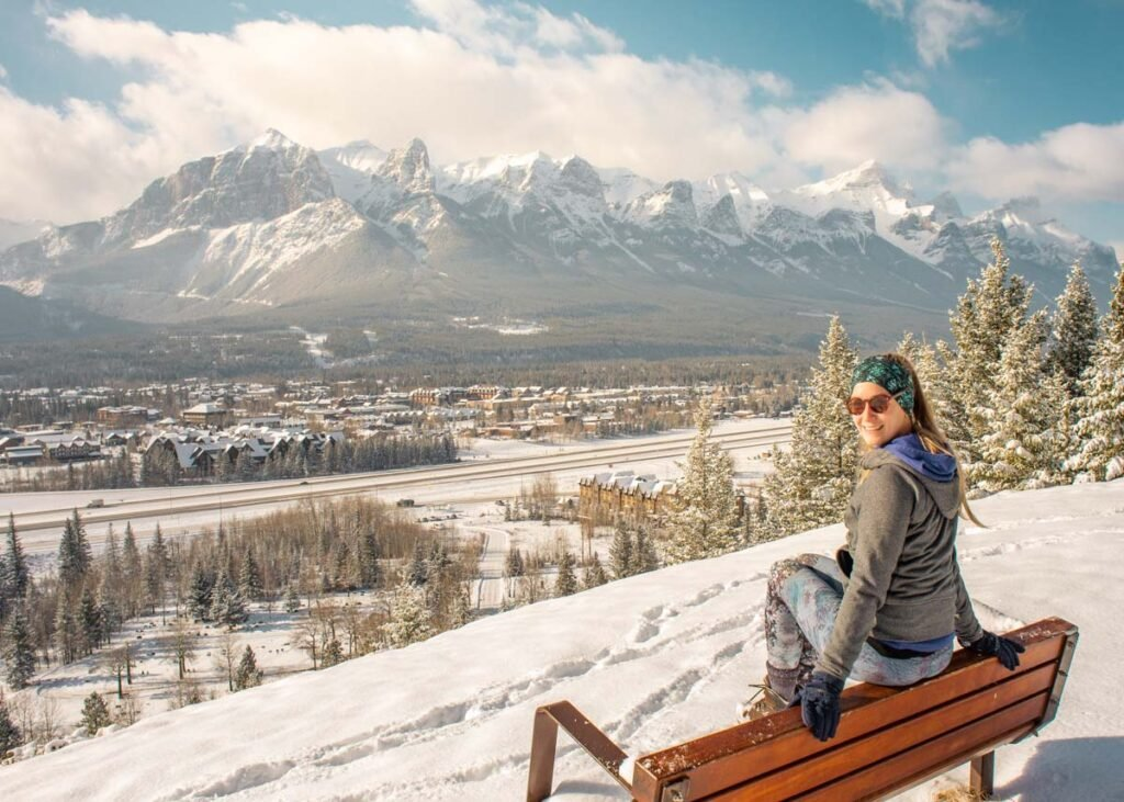 Woman at a viewpoint in Canmore in the winter