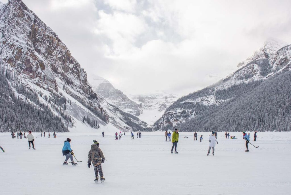 people skating at Lake Louise in the winter