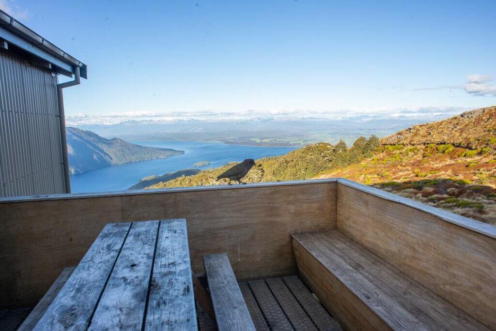 A Kea hangs outside the Luxmore Hut in New Zealand