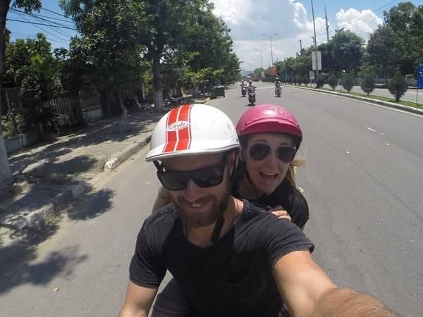 bailey adn Daniel ride a scooter in Asia
