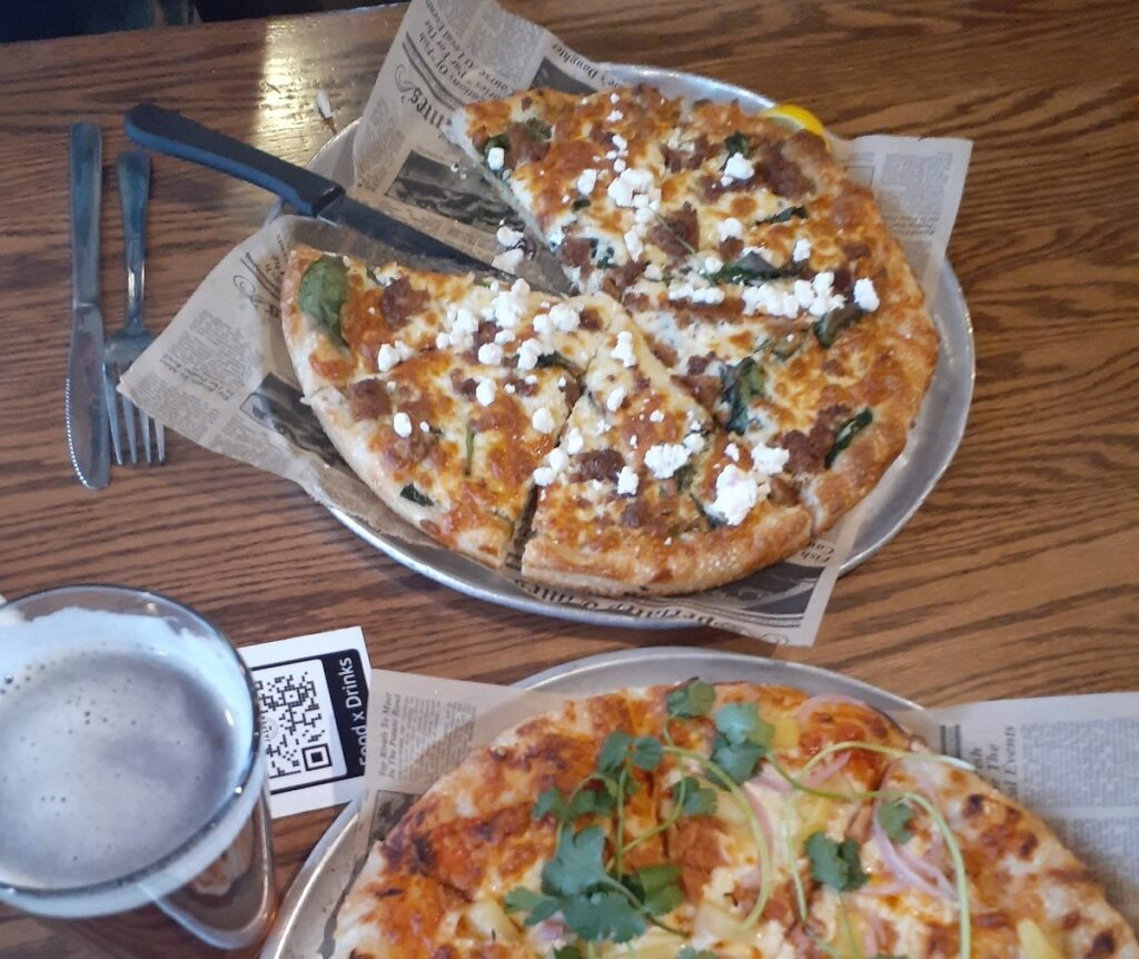 two pizzas from the Jasper Pizza Place