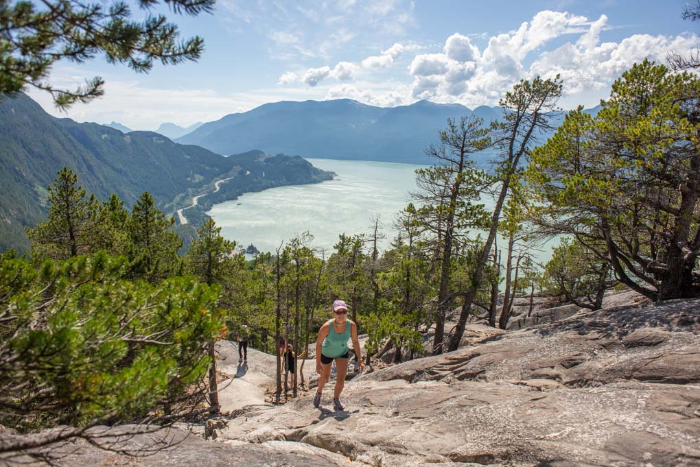 A lady walks up the Stawamus Chief track in Vancouver, BC