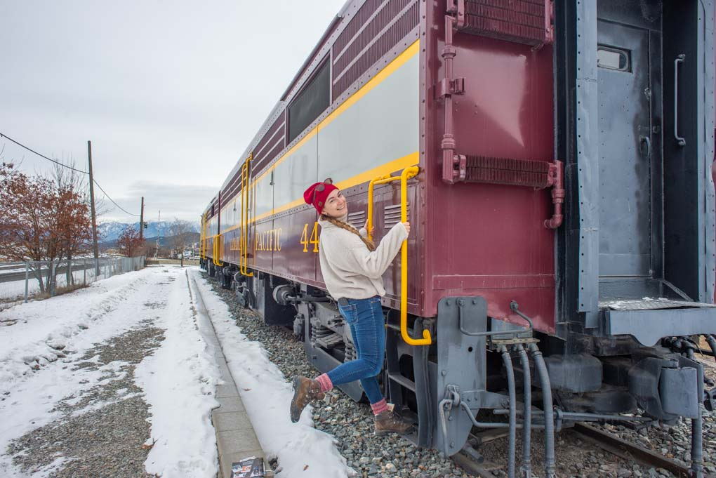 Bailey on an old train on display in Cranbrook