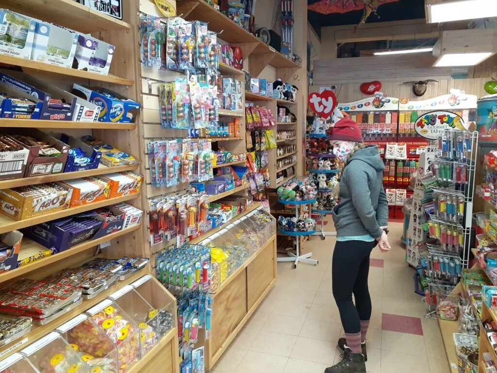 woman shopping inside the Old Tyme Candy Shop in Radium, BC