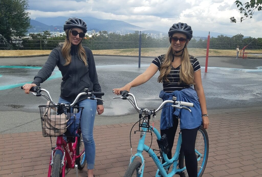 two ladies riding bikes at Stanley Park in Vancouver