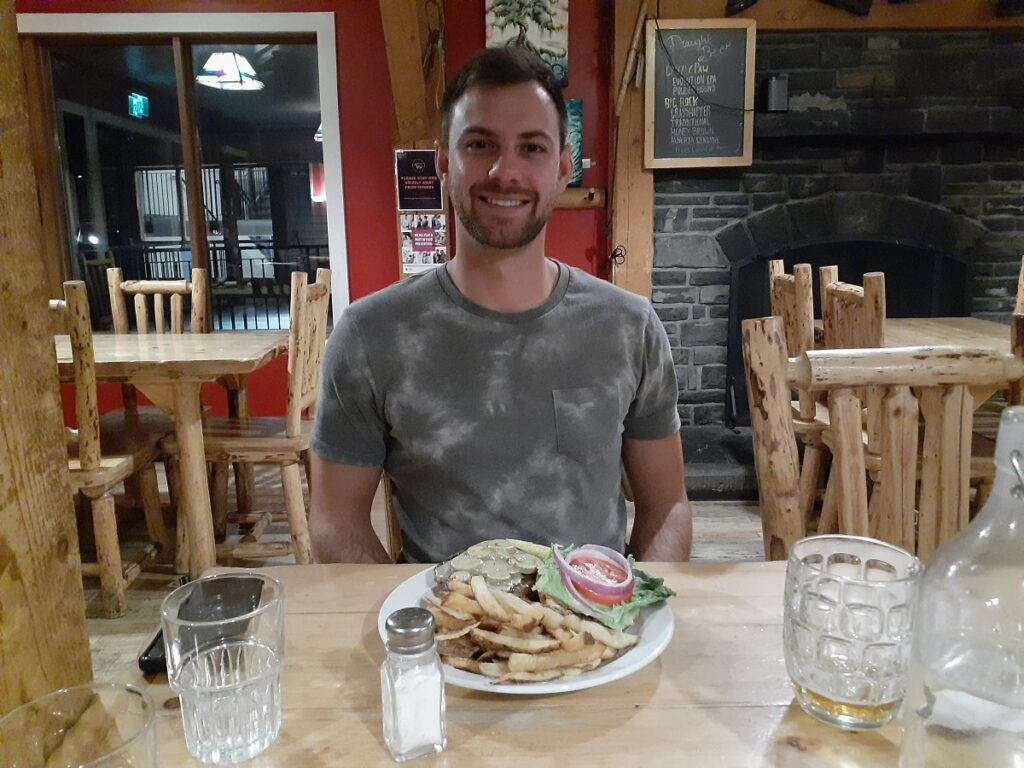 man eating at one of the best restaurants in Lake Louise