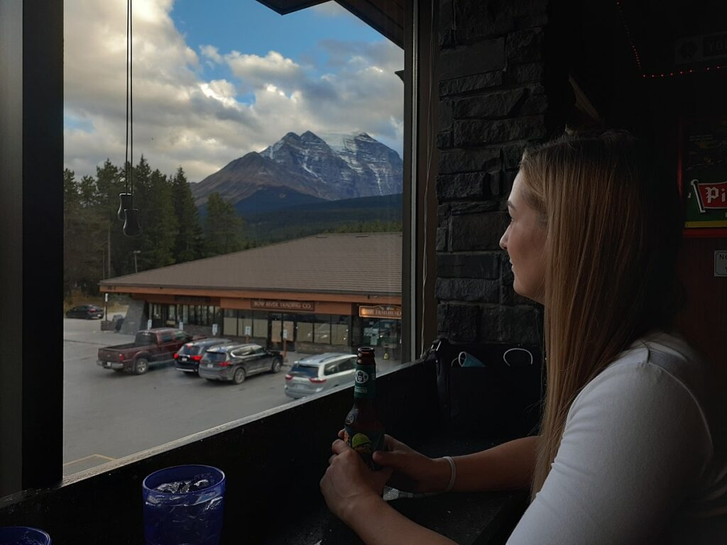 woman enjoying the view from the Village Grill Restaurant in Lake Louise