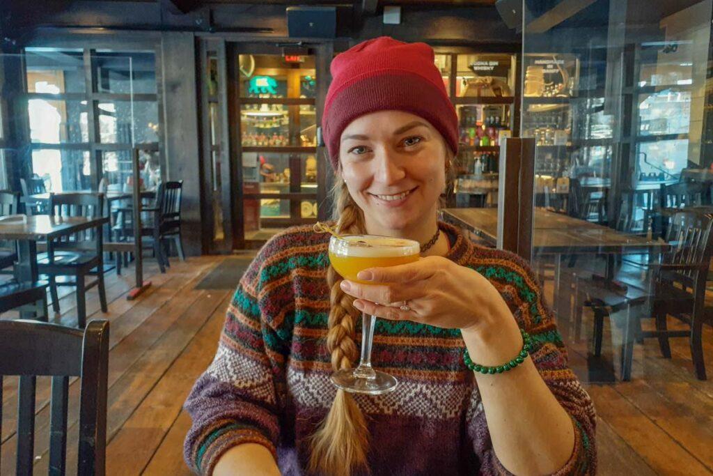 Bailey drinks a cocktail Park Distillery Restaurant and Bar
