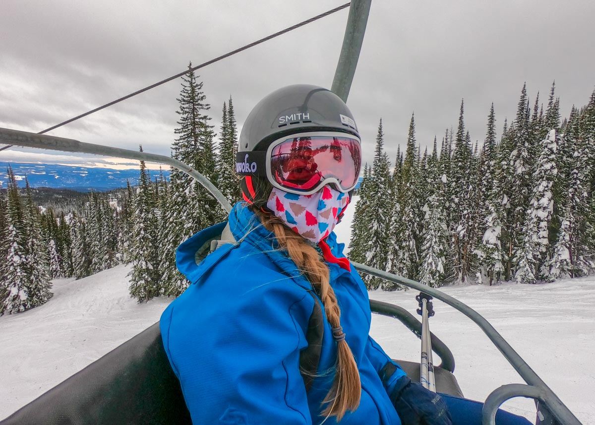 A lady on a chairlift at Big White Ski Resort near Kelowna, BC in winter