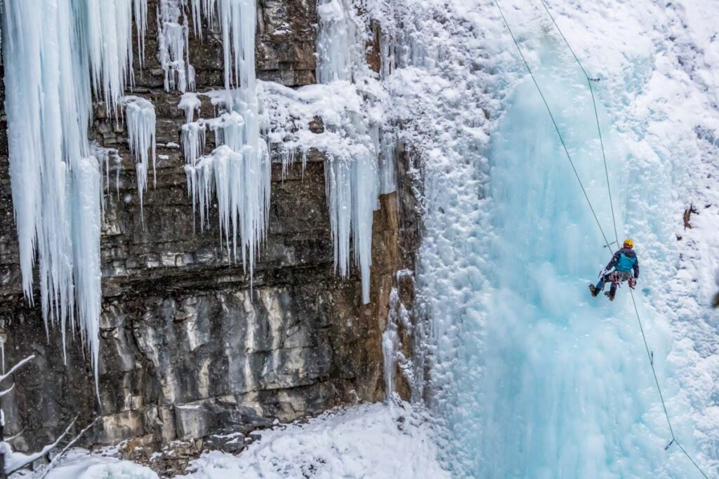 A person Ice Climbs in Johnston Canyon