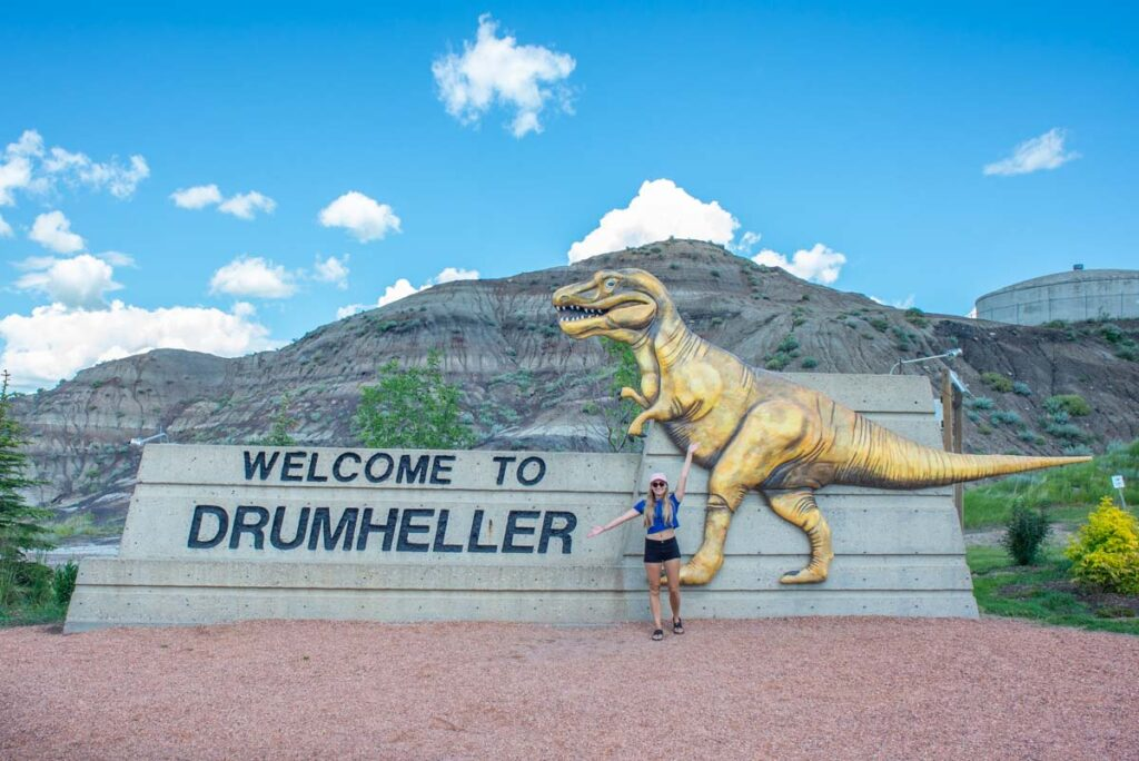 """Taking a picture with the """"Drumheller"""" sign"""