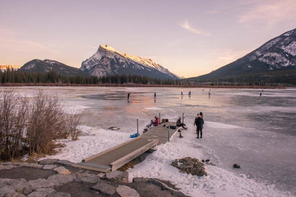 People Ice skating on Vermillion Lakes near Banff