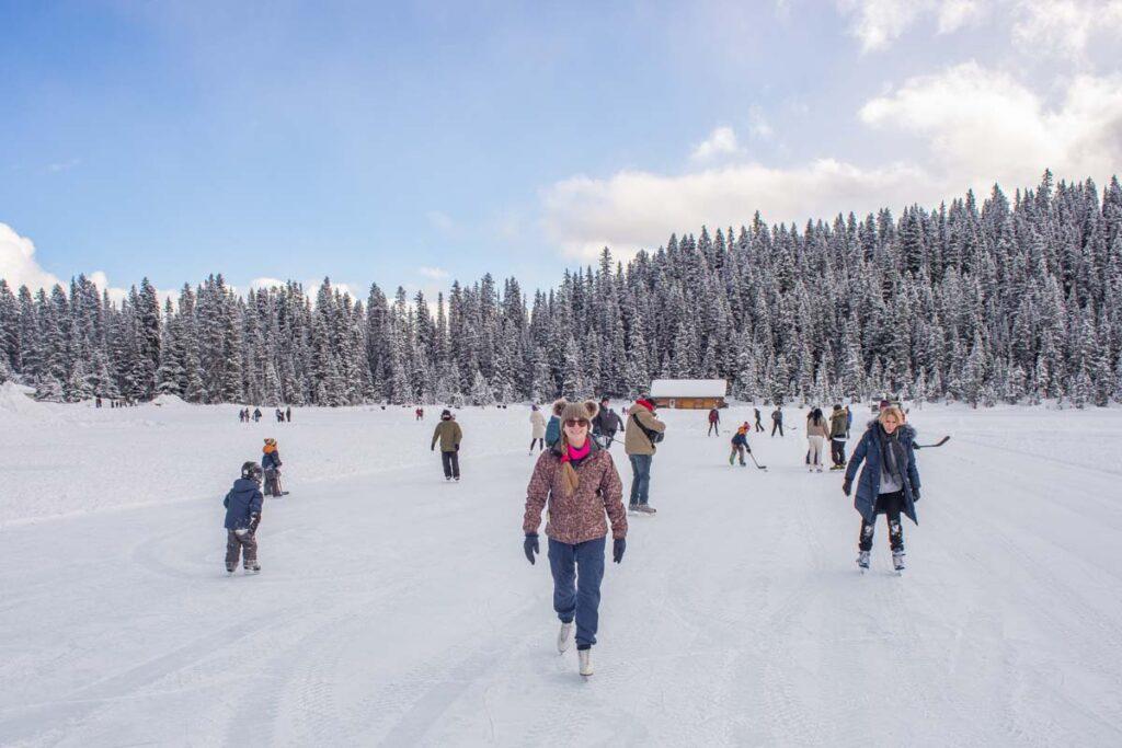 A lady ice skates on Lake Louise