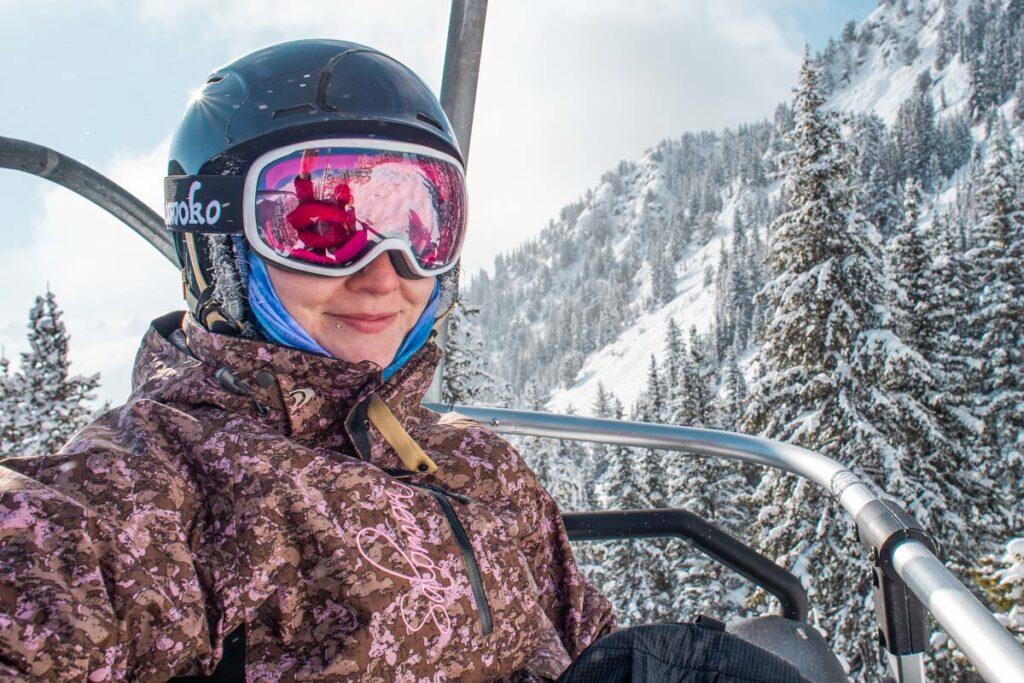 Bailey from Exploring BC and Alberta on a gondola at Nakiska Ski Resort near Calgary