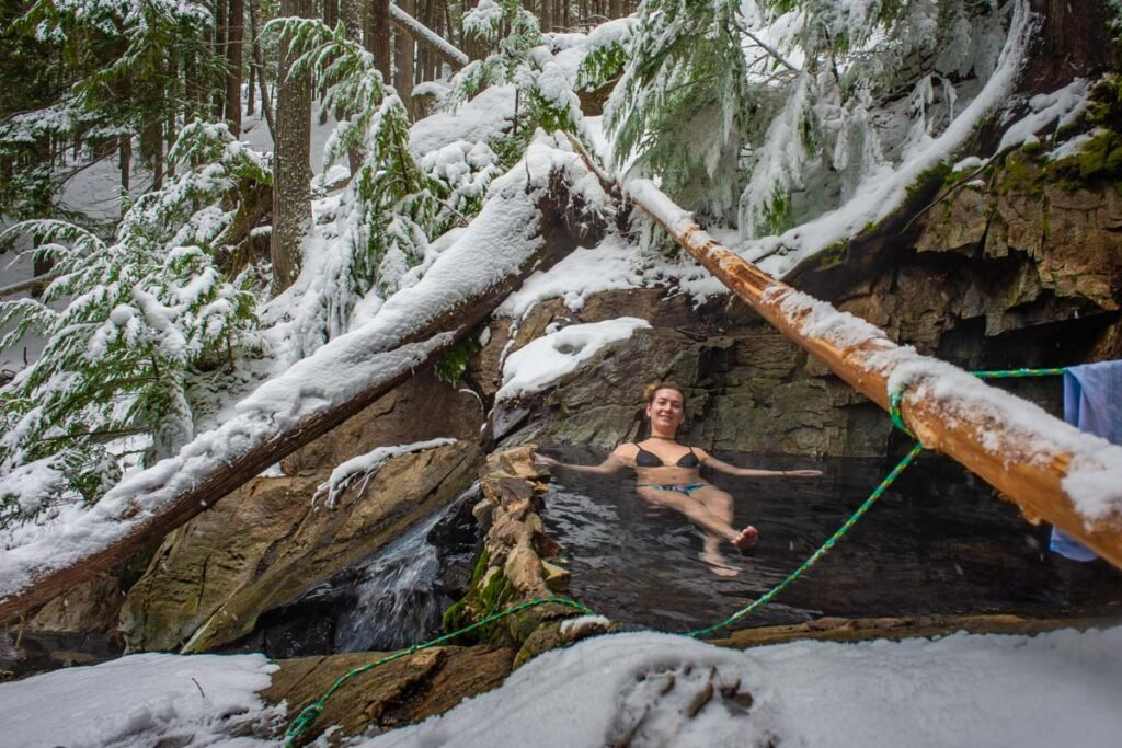 A lady relaxes in St Leon Hot Springs near Revelstoke, BC