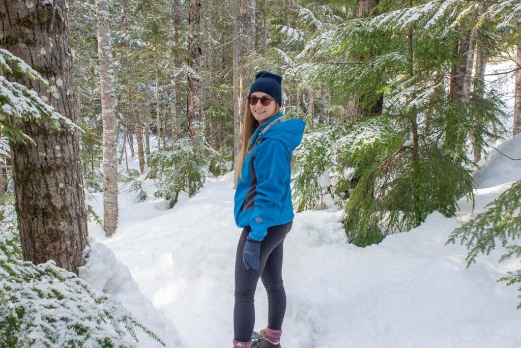 Bailey from Destinationless Travel snowshoeing