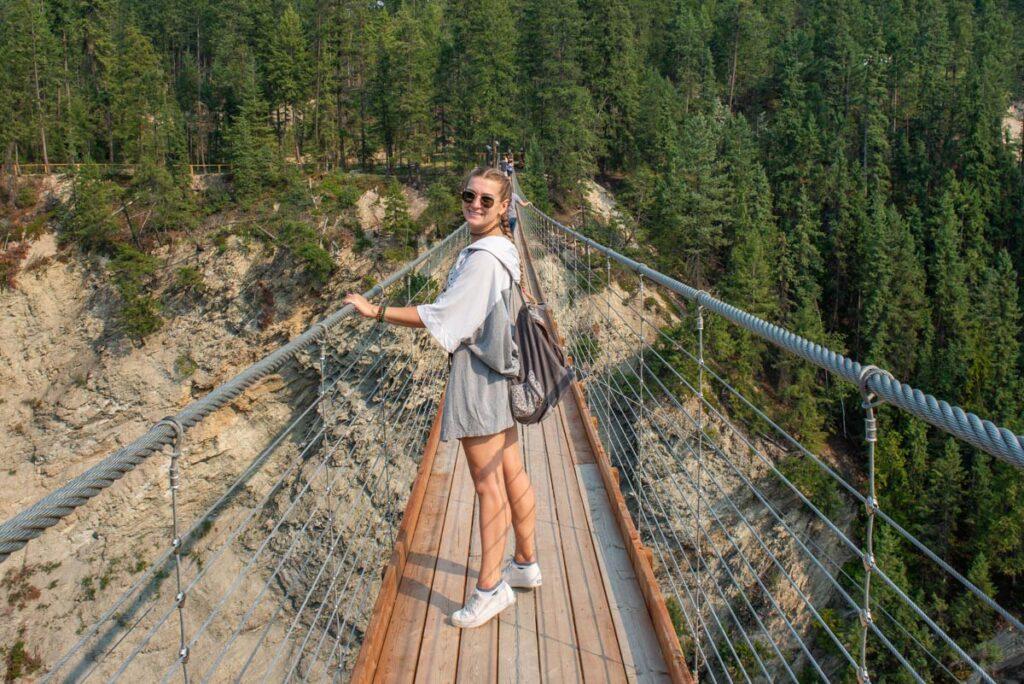 Vailey from Destinationless Travel walks along the Golden Sky Bridge