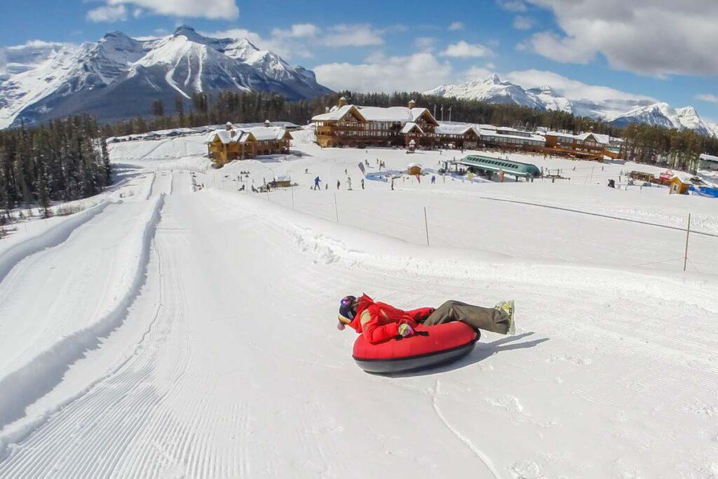 A kid slides down the Lake Louise Tube Park