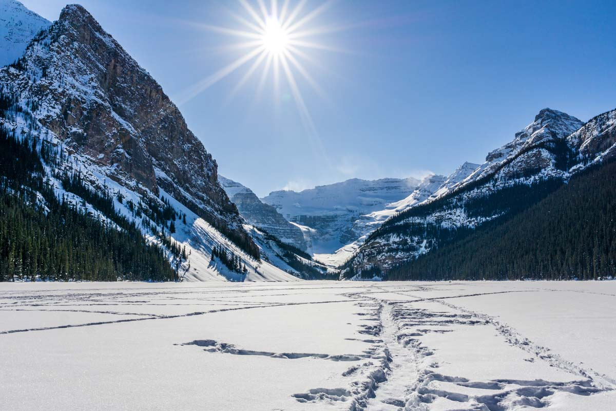 A frozen Lake Louise with mountain views in winter