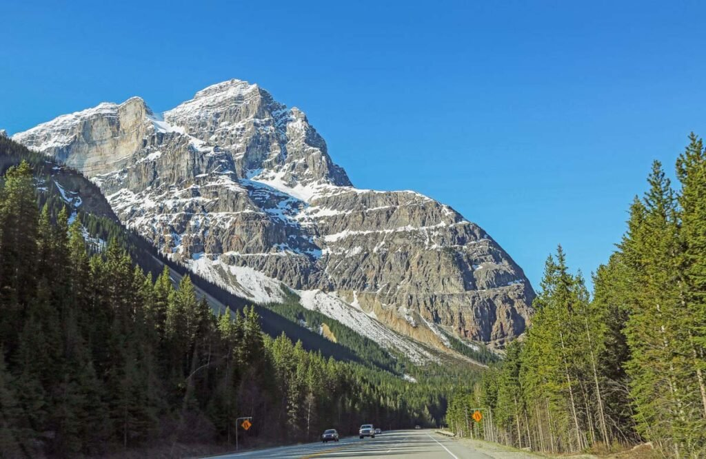 A road with mountain views in Yoho National Park