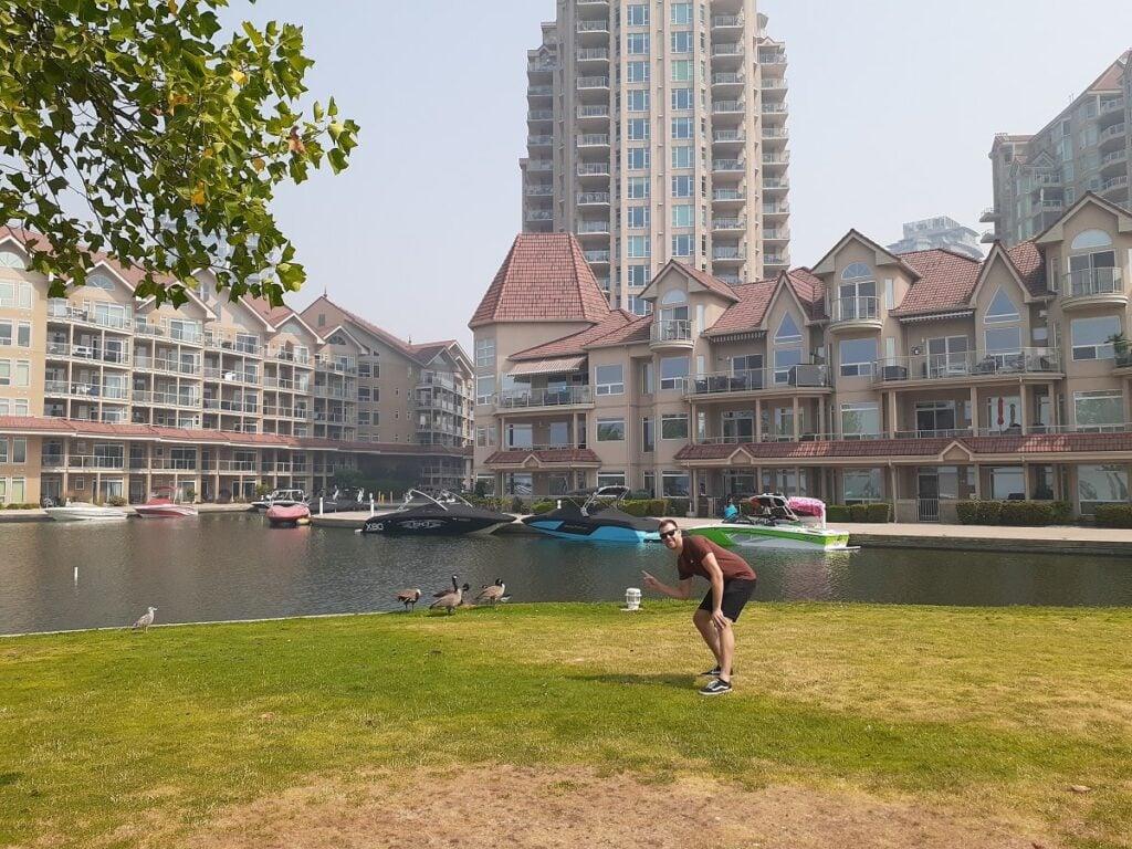 man poses infront of a marina Hotel in Kelowna