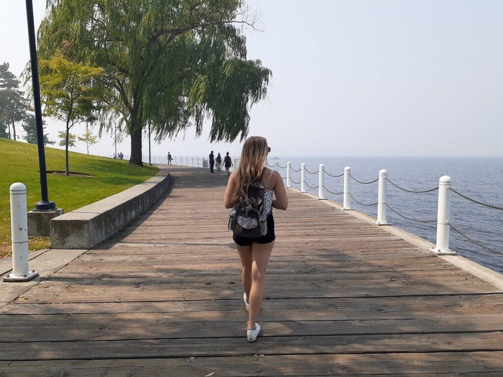 woman walking the boardwalk in Kelowna, BC