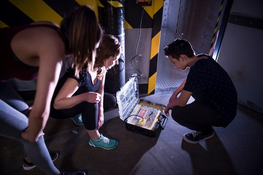 people trying to solve a clue at The Locked Room in Calgary